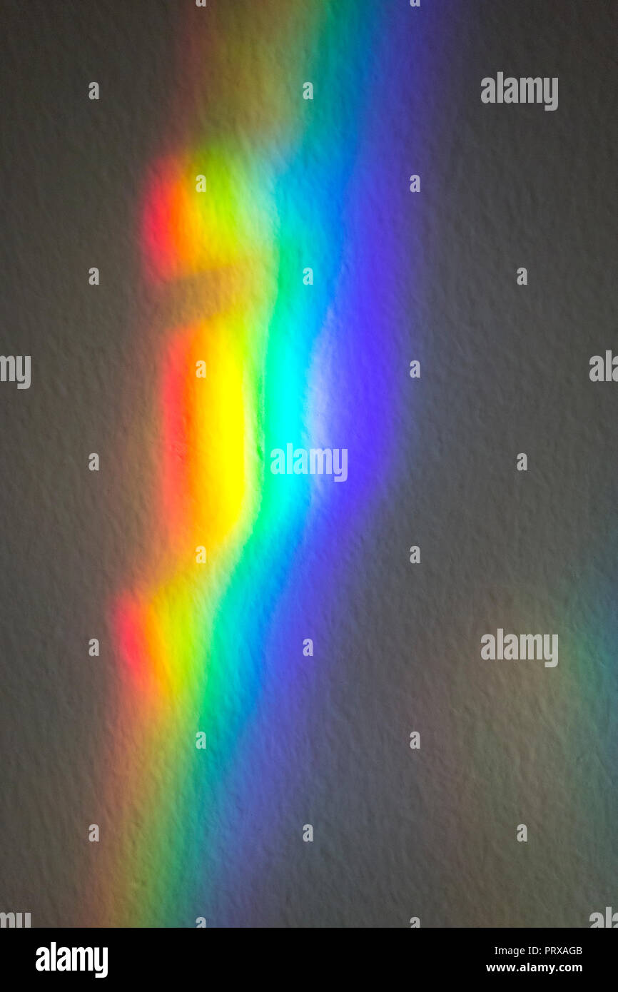 Light refraction on the wall. Spectrum of colors. Light refraction through window glass. Portugal - Stock Image