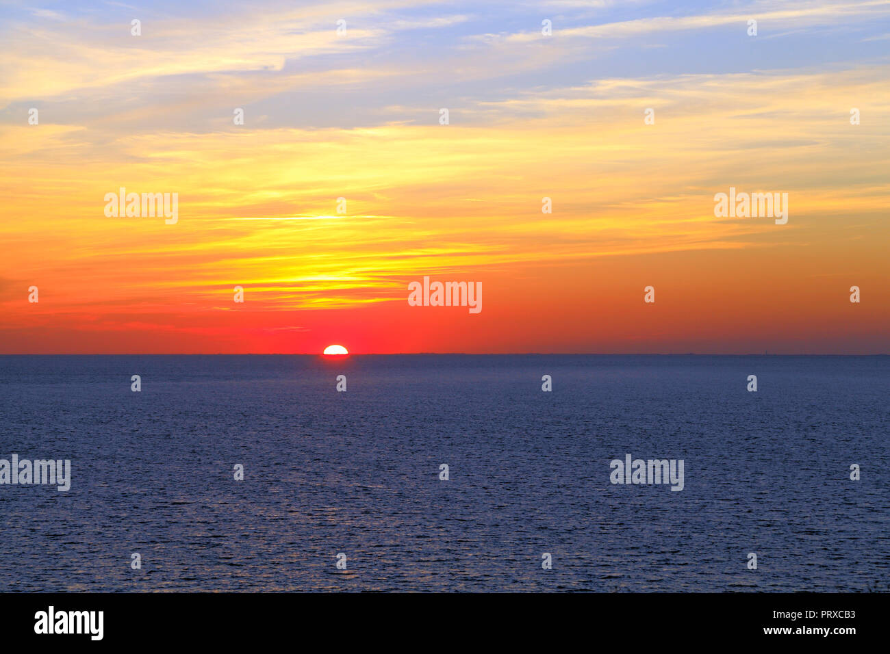 Autumnal sunset, blue sea, The Wash, from Hunstanton, Norfolk, red sky, skies - Stock Image
