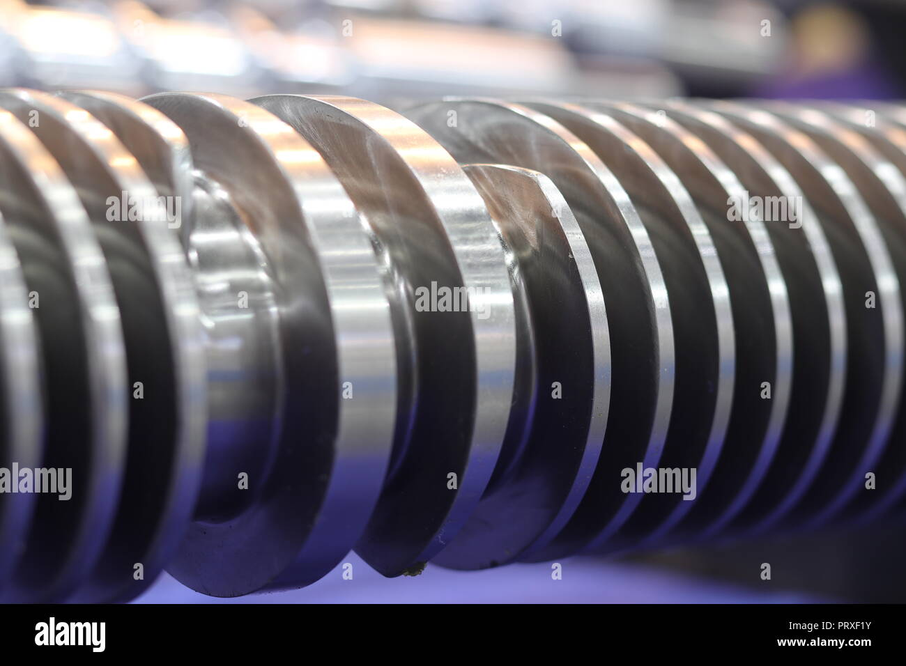 Screw press parts for plastic injection machine ; selective focus Stock Photo