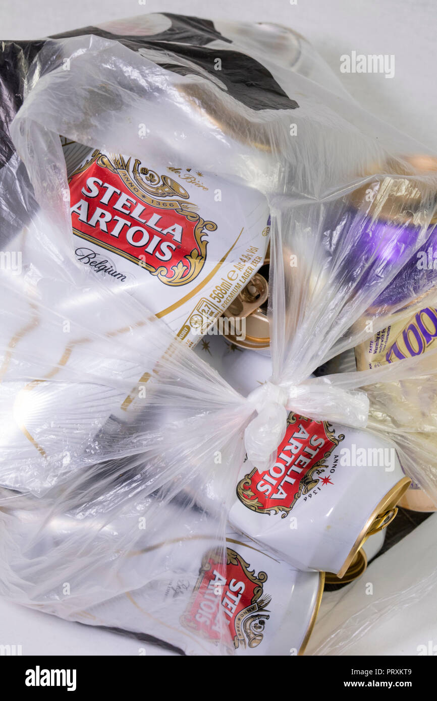Beer and Larger cans in a plastic bag, England, UK - Stock Image