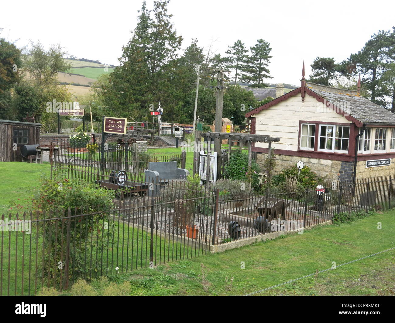 The platform & former station at Gotherington is adorned with colourful pots of flowers & hanging baskets: Gloucestershire Warwickshire Steam Railway - Stock Image