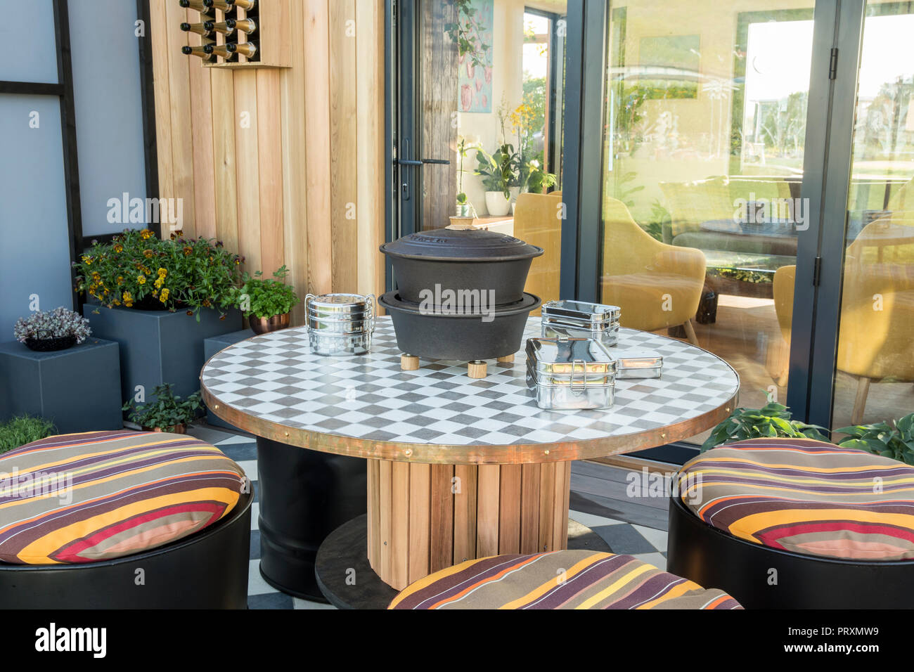 Balcony Garden With Repurposed Recycled Wooden Table And Oil Drum Seats Cushions Outdoor Dining Area Patio Violas Succulents And Micro Greens Grow Stock Photo Alamy