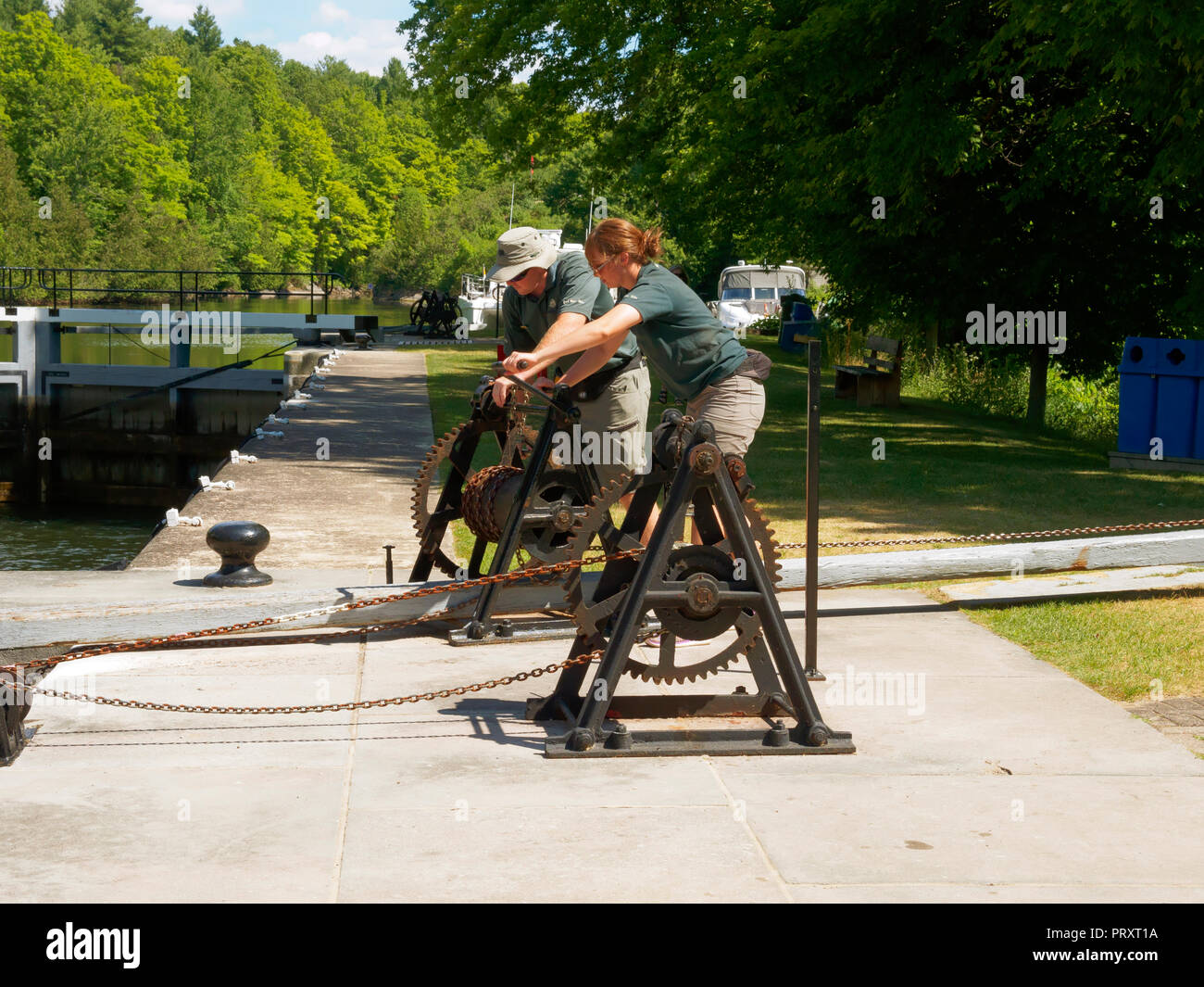 Lock keepers operate the locks by hand on the Rideau Canal, Ontario, Canada - Stock Image