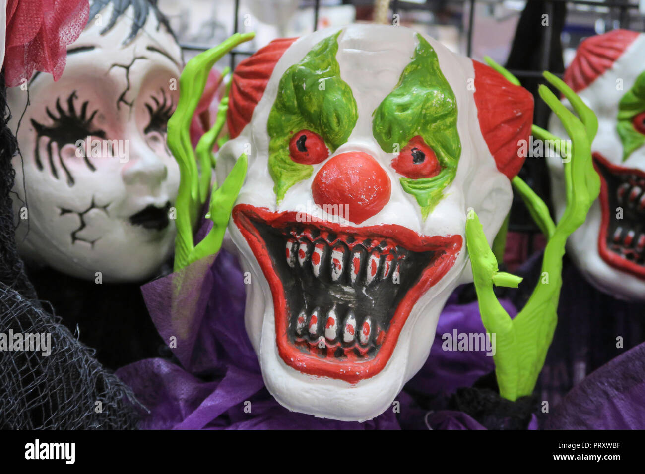 halloween masks for sale at party city store, nyc, usa stock photo