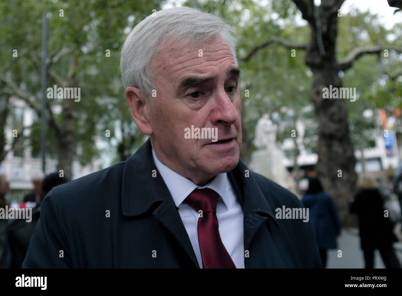 John McDonnell, Labor Member of Parliament seen during the demonstration. Wetherspoons, TGI Fridays, and McDonald's workers rally together in London to demand better working conditions and a fair pay in the hospitality industry. - Stock Image