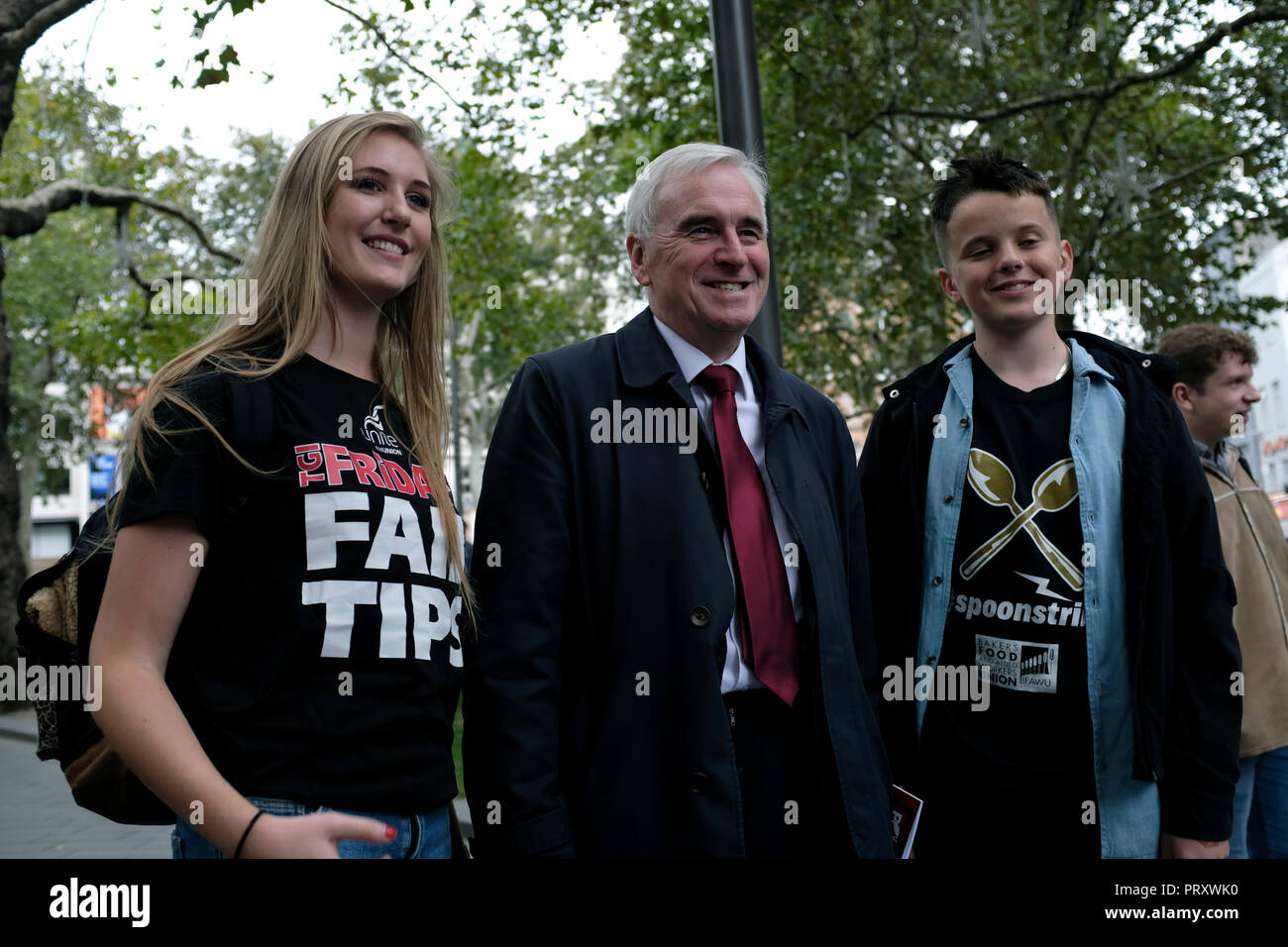 John McDonnell (centre), Labor Member of Parliament seen during the demonstration. Wetherspoons, TGI Fridays, and McDonald's workers rally together in London to demand better working conditions and a fair pay in the hospitality industry. - Stock Image
