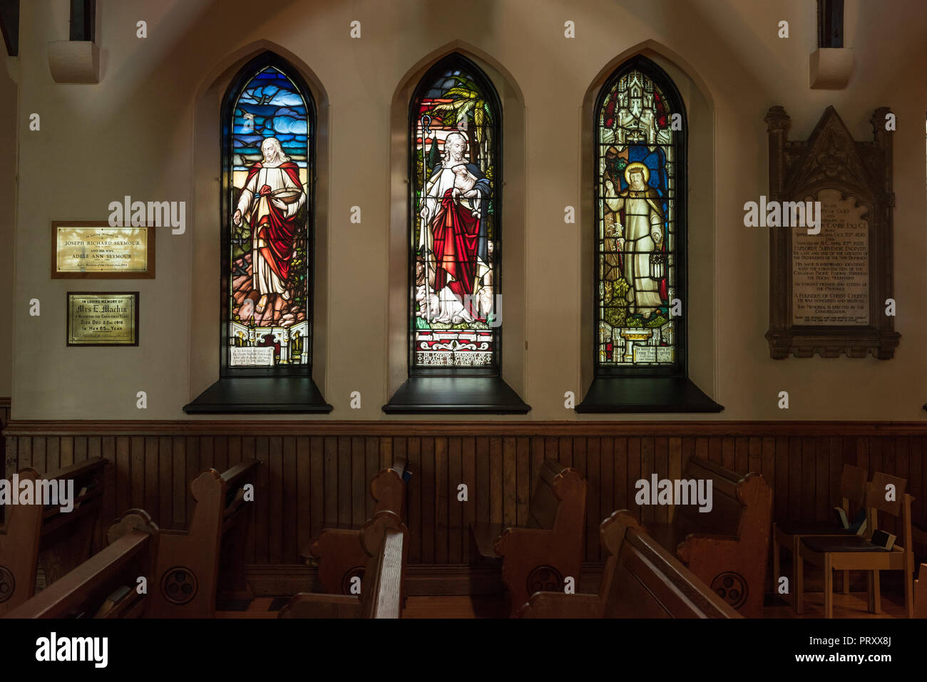 Stain glass windows in Gothic Style arches, interior of the Christ Church Cathedral, Vancouver City. - Stock Image
