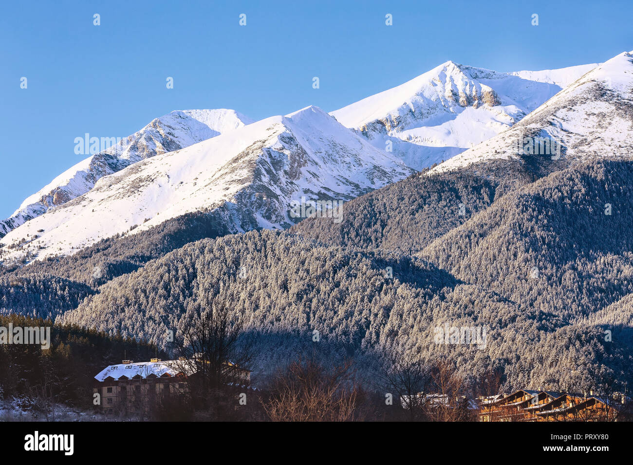 houses and snow mountains landscape sunrise panorama in bulgarian