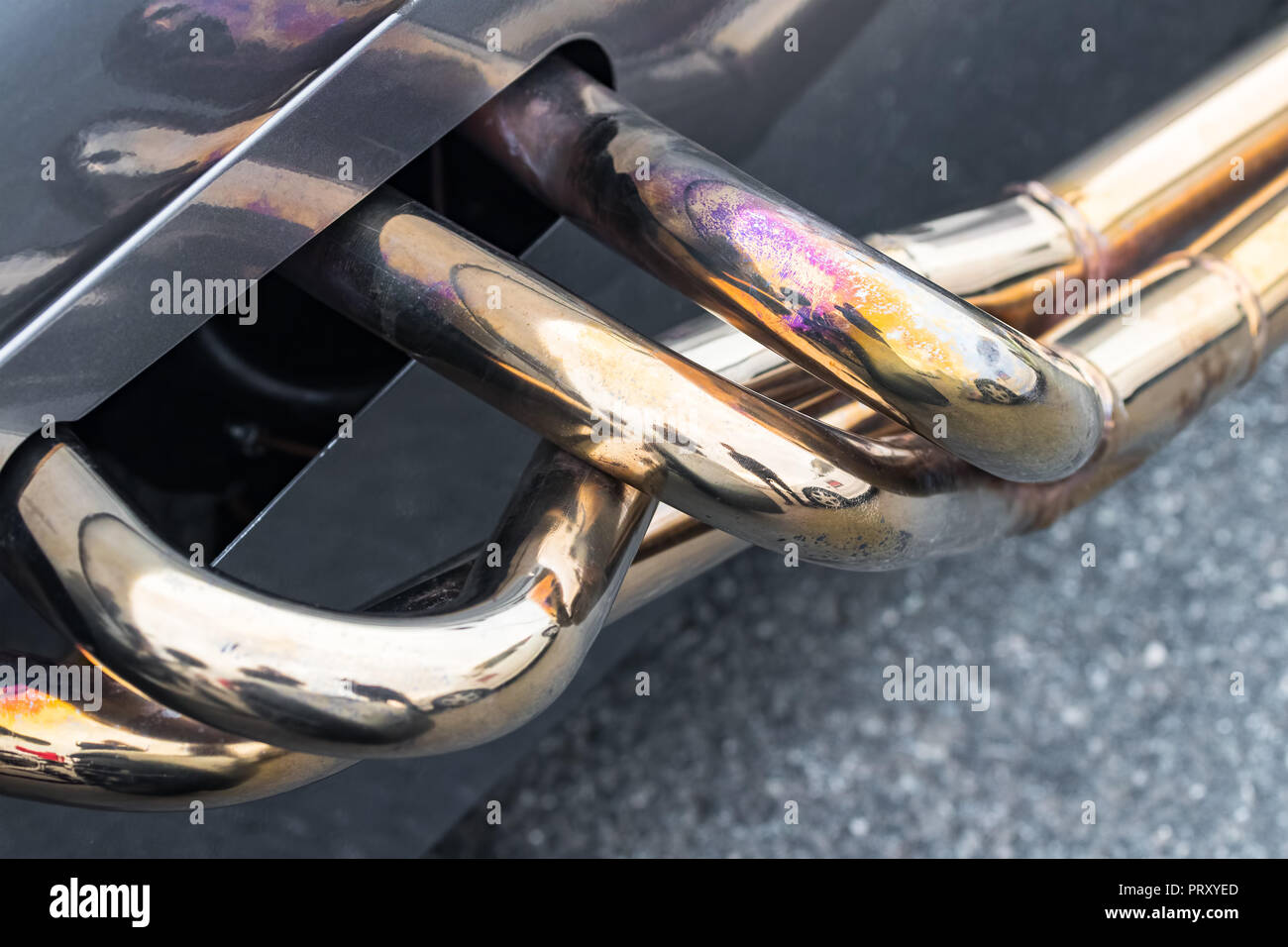 Exhaust Manifold Pipes With Shiny Coating On A Race Car Stock Photo