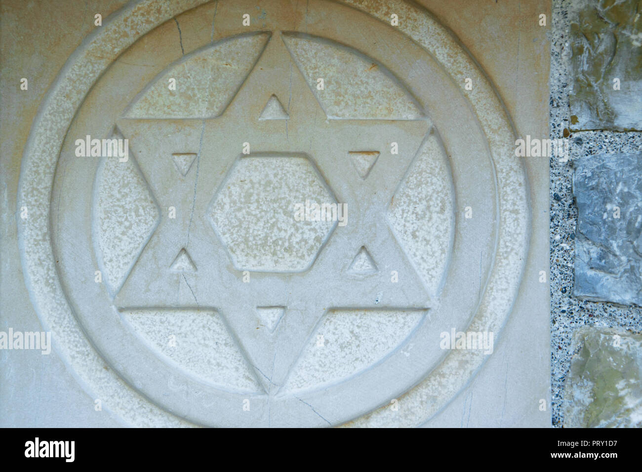 the-star-of-david-engraved-in-the-marble-traditional-symbol-of-modern-jewish-identity-and-judaism-PRY1D7.jpg