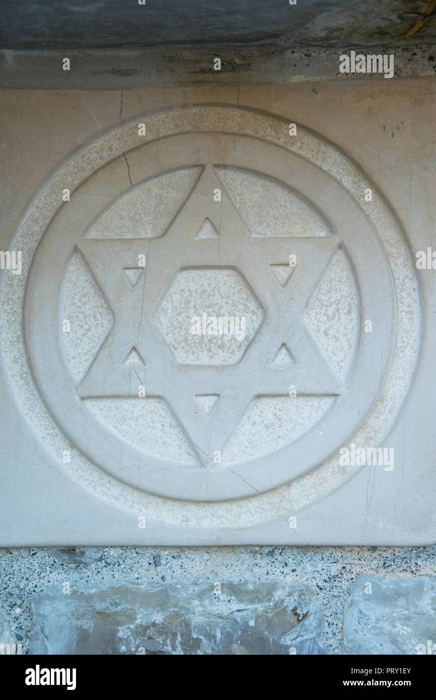 The Star of David engraved in the marble - traditional symbol of modern Jewish identity and Judaism - Stock Image