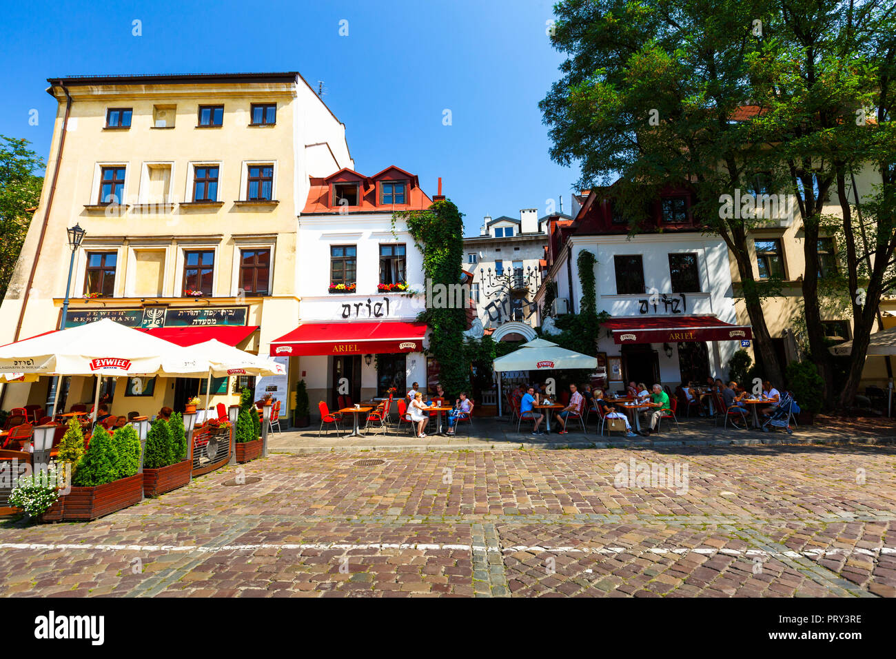 Krakow, Poland - August 23, 2018: Restaurants and coffee shops in centre of Kazimierz district in Krakow, Poland. - Stock Image