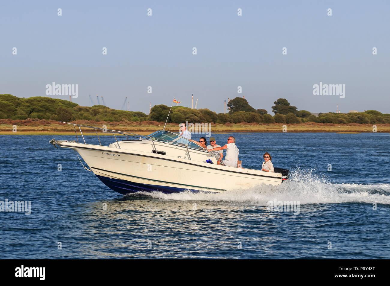 Huelva, Spain - July 16, 2017: Unidentified people enjoy activities on motor boat in Huelva bay - Stock Image