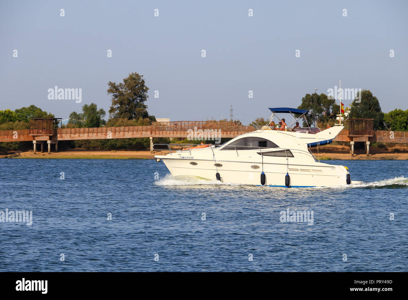 Huelva, Spain - July 16, 2017: Unidentified people enjoy activities on motor boat Punta Umbria beach - Stock Image