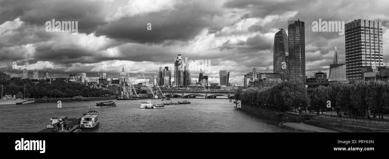 Panoramic view looking east from Waterloo Bridge over the River Thames to the City of London financial district skyscrapers and St Paul's Cathedral Stock Photo