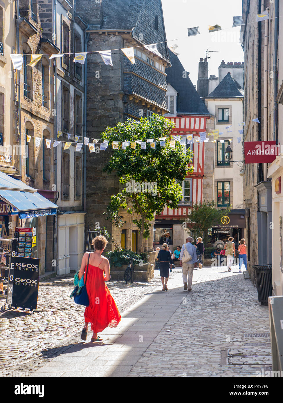 Quimper old town historic medieval pedestrian shopping centre with summer sun shoppers tourists & visitors Quimper Brittany Finistère France - Stock Image