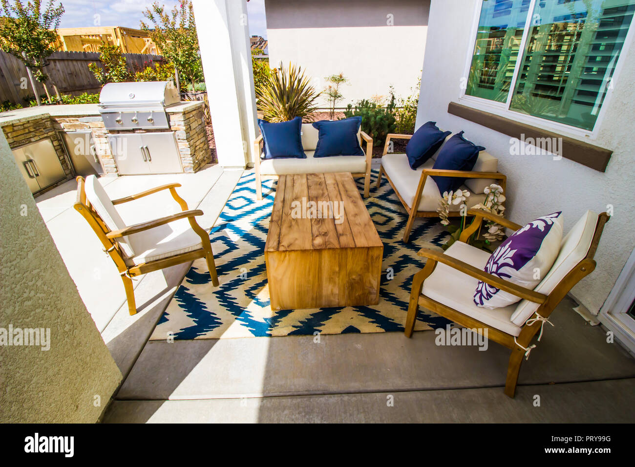 Outdoor Rear Yard Patio With BBQ & Furniture - Stock Image