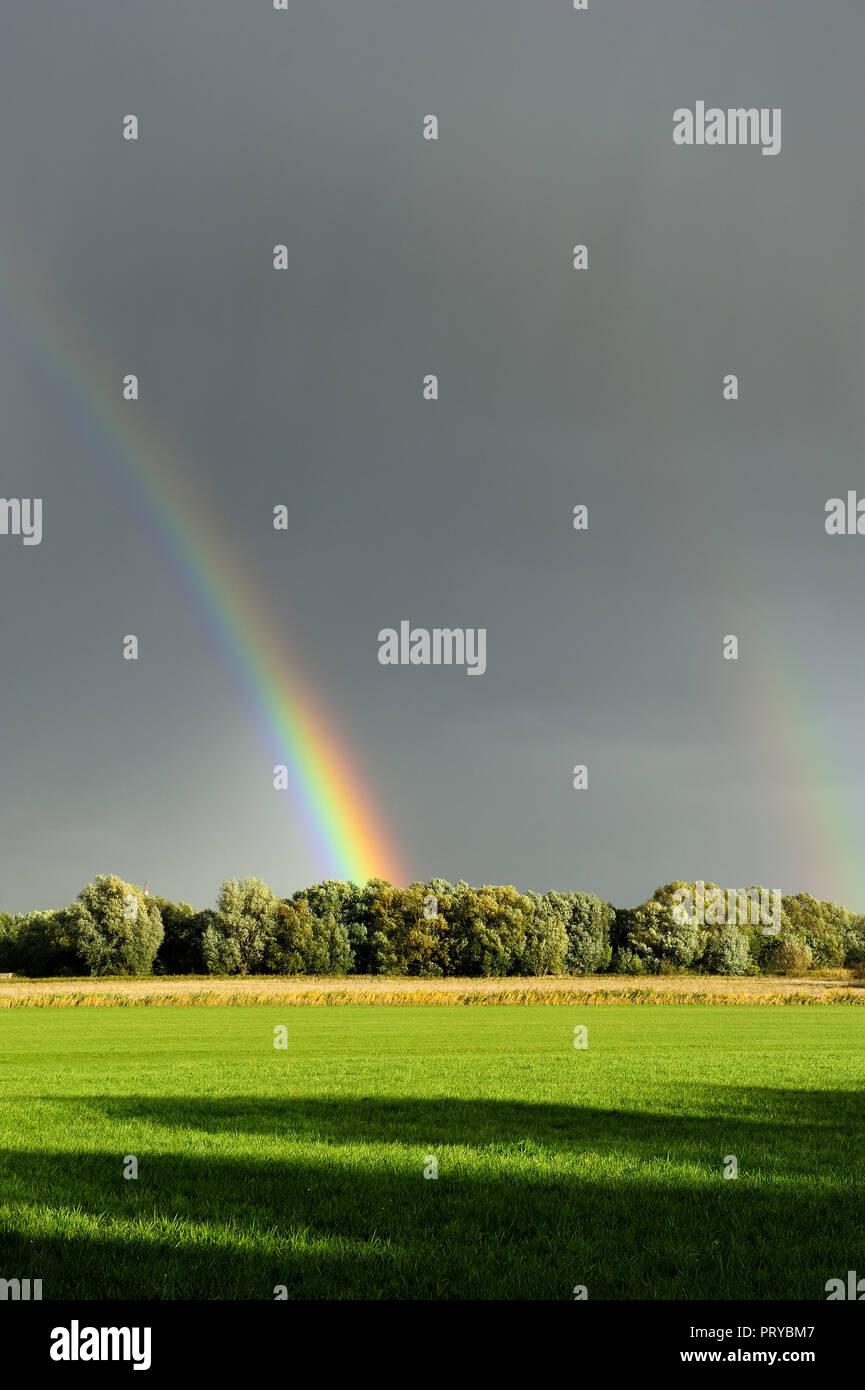 autumn, scenery, rainbow, climat, cumulus clouds, autumn, coming, scenic, travel, clouds, idyllic, rain shower, sunshine, sunlight, - Stock Image