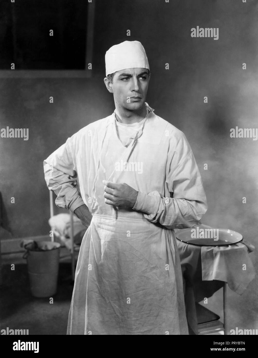 Prod DB © Universal Pictures / DR  LE SECRET MAGNIFIQUE MAGNIFICIENT OBSESSION de John Stahl 1935 USA  Robert Taylor. blouse blanche; chirurgien; doct - Stock Image