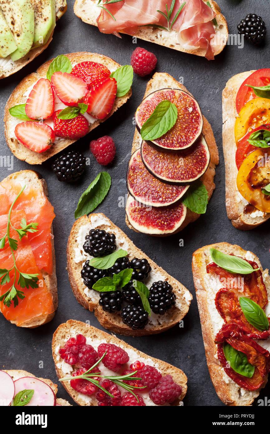 Brushetta or traditional spanish tapas. Appetizers italian antipasti snacks set. Top view and flat lay - Stock Image
