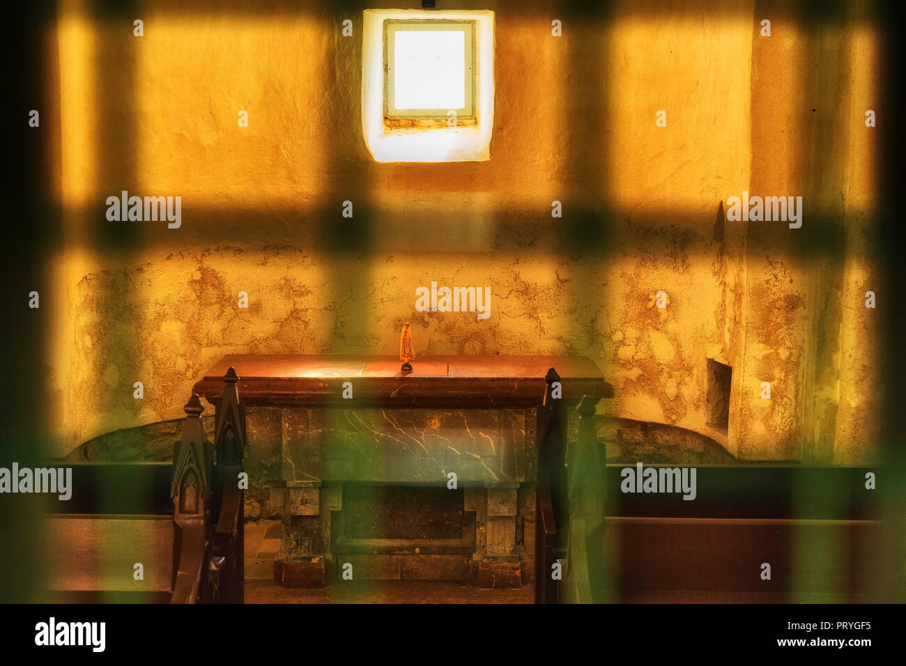 chapel altar with sunshine thropugh little window - Stock Image