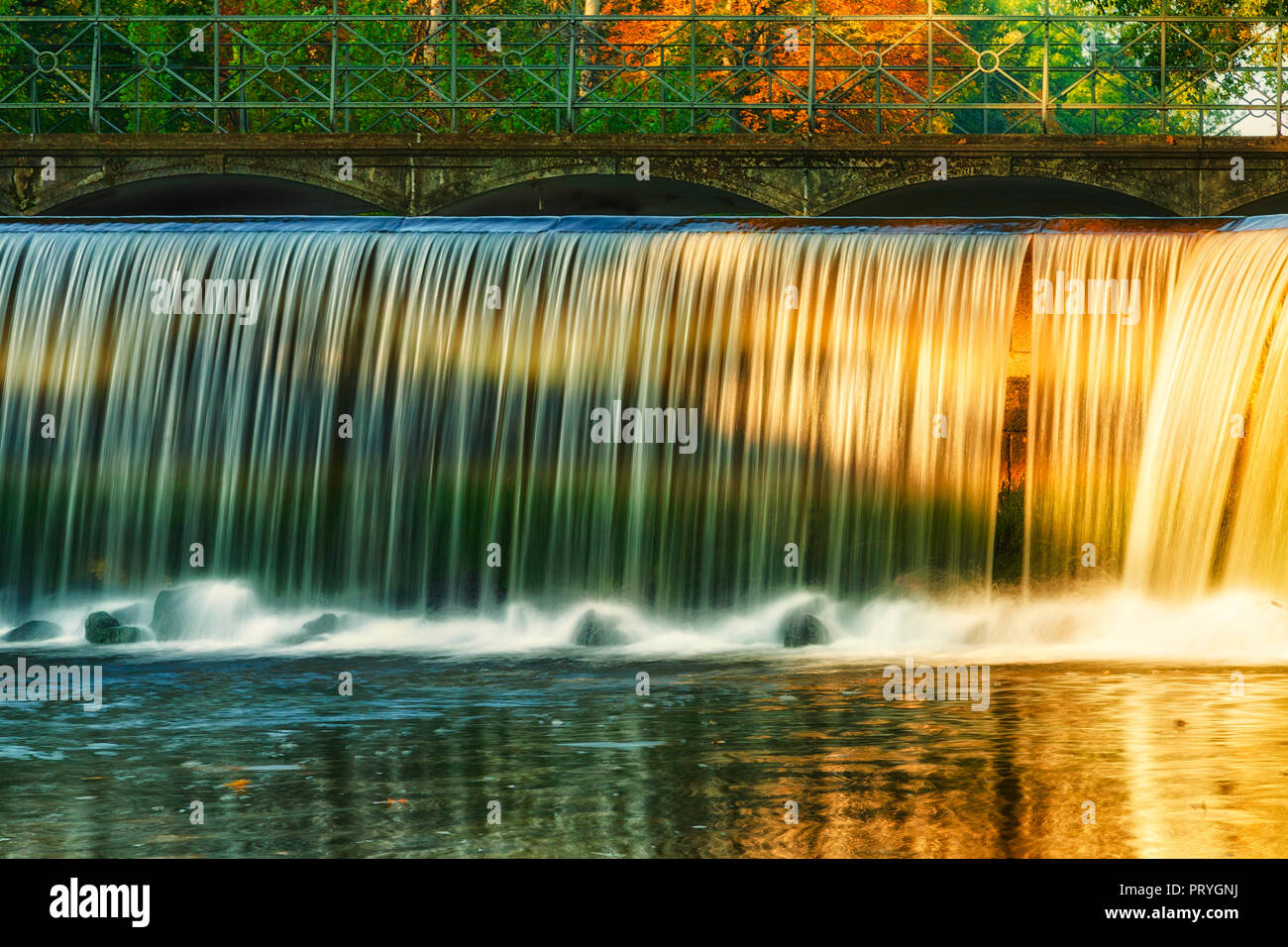 Water fall and sun - Stock Image