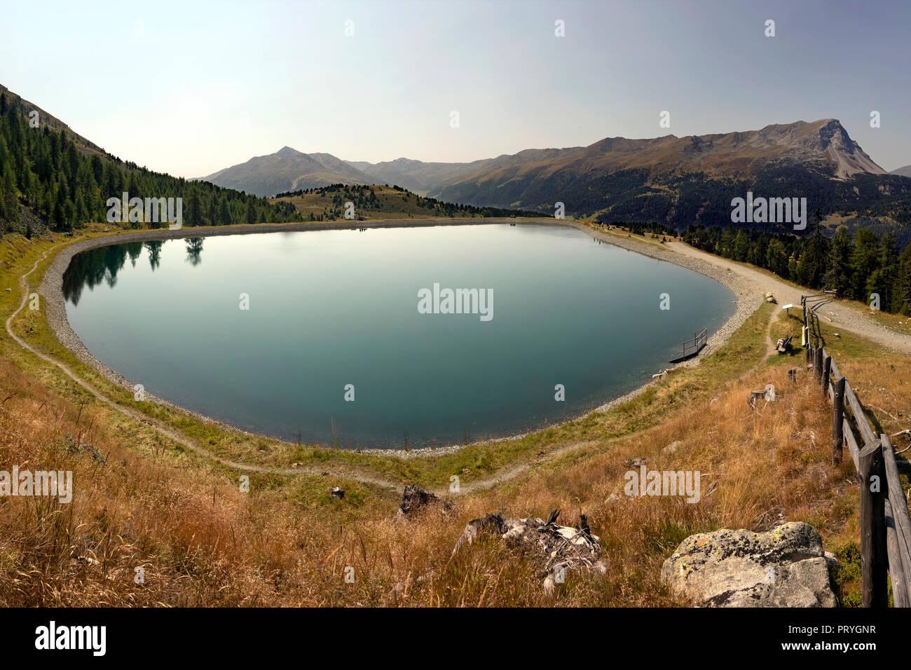 Kompatschwald reservoir, Reschenpass, Vinschgau, South Tyrol, Italy - Stock Image