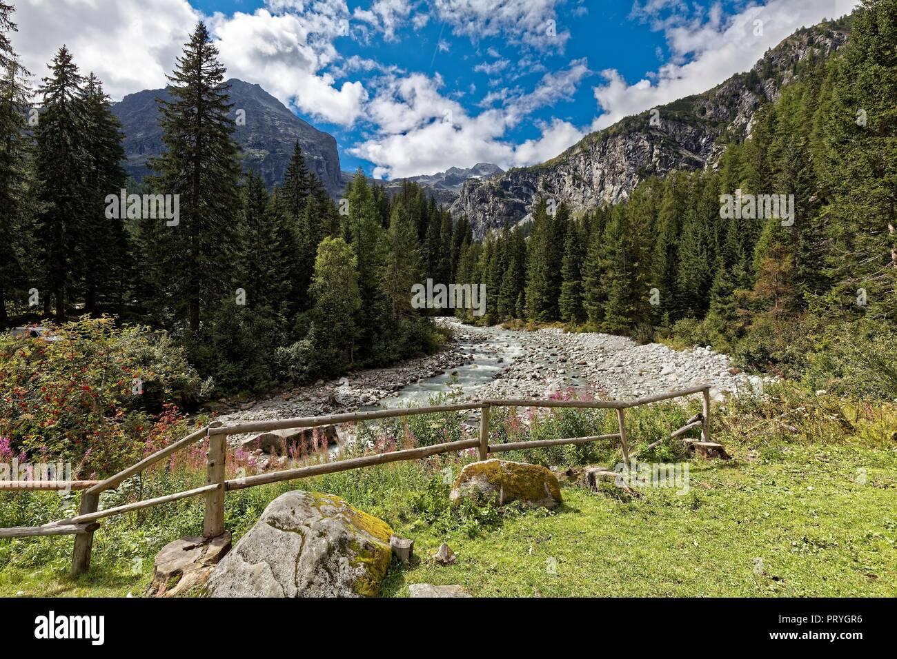 Mountain river Sarca flows through mountainous landscape, mountains, at Refugio Adamello Collini al Bedole, Val Genova - Stock Image