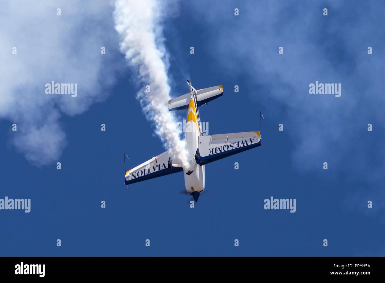 British aerobatic pilot Mark Jefferies flying a single engine Extra 330LX aerobatic aircraft VH-IXN. - Stock Image