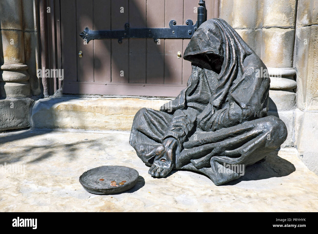 Jesus the beggar sculpture based on Matthew 25:40, created by Timothy Schmalz, sits outside the Old Stone Church in Cleveland, Ohio, USA. - Stock Image