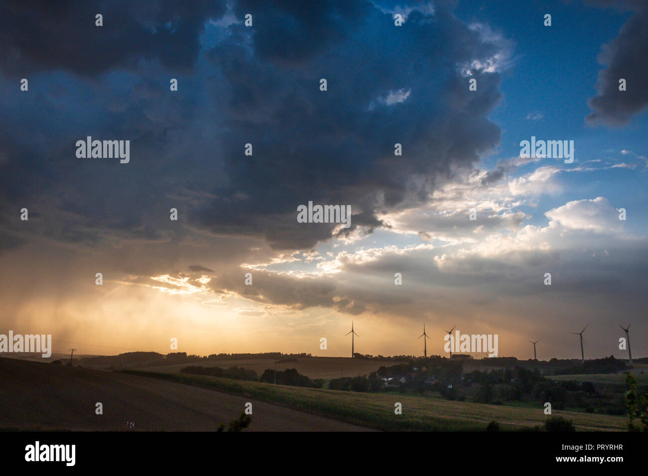 Germany, Lausitz, wind wheels and  thundercloud - Stock Image