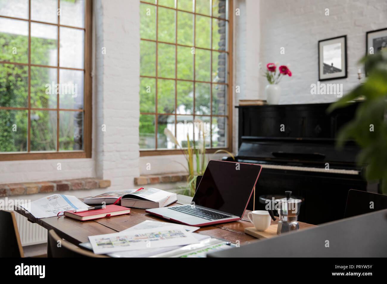 Home Office With Piano In Background At Comfortable Loft Apartment