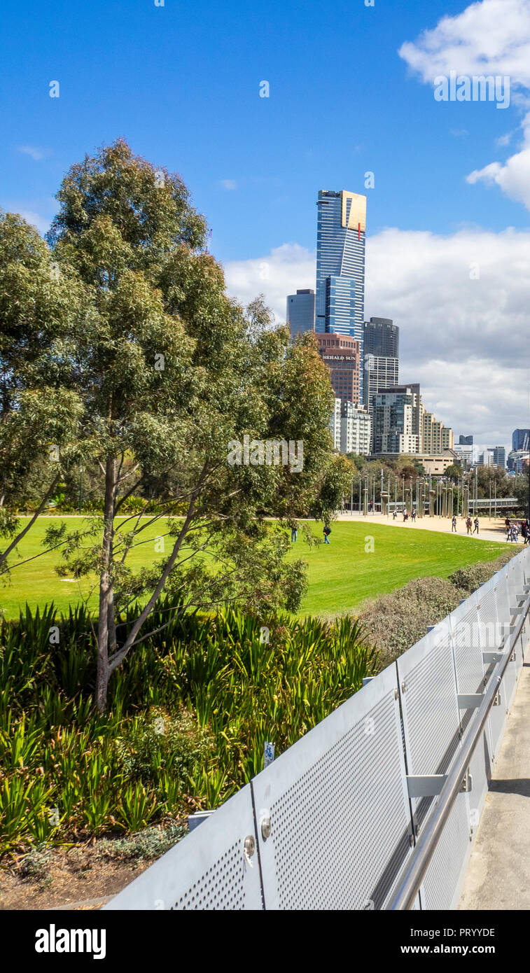 Birrarung Marr, a park by the Yarra River with the Eureka Residential skyscraper tower in Melbourne Victoria Australia. - Stock Image