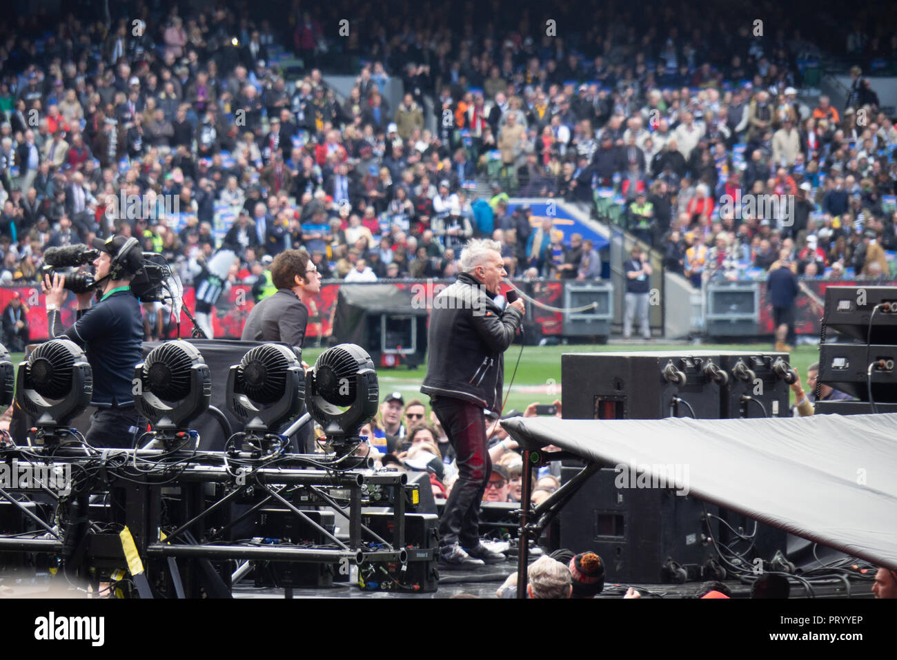 Australian rocker Jimmy Barnes singing in concert at the 2018 AFL Grand Final at the MCG Melbourne Victoria Australia. - Stock Image