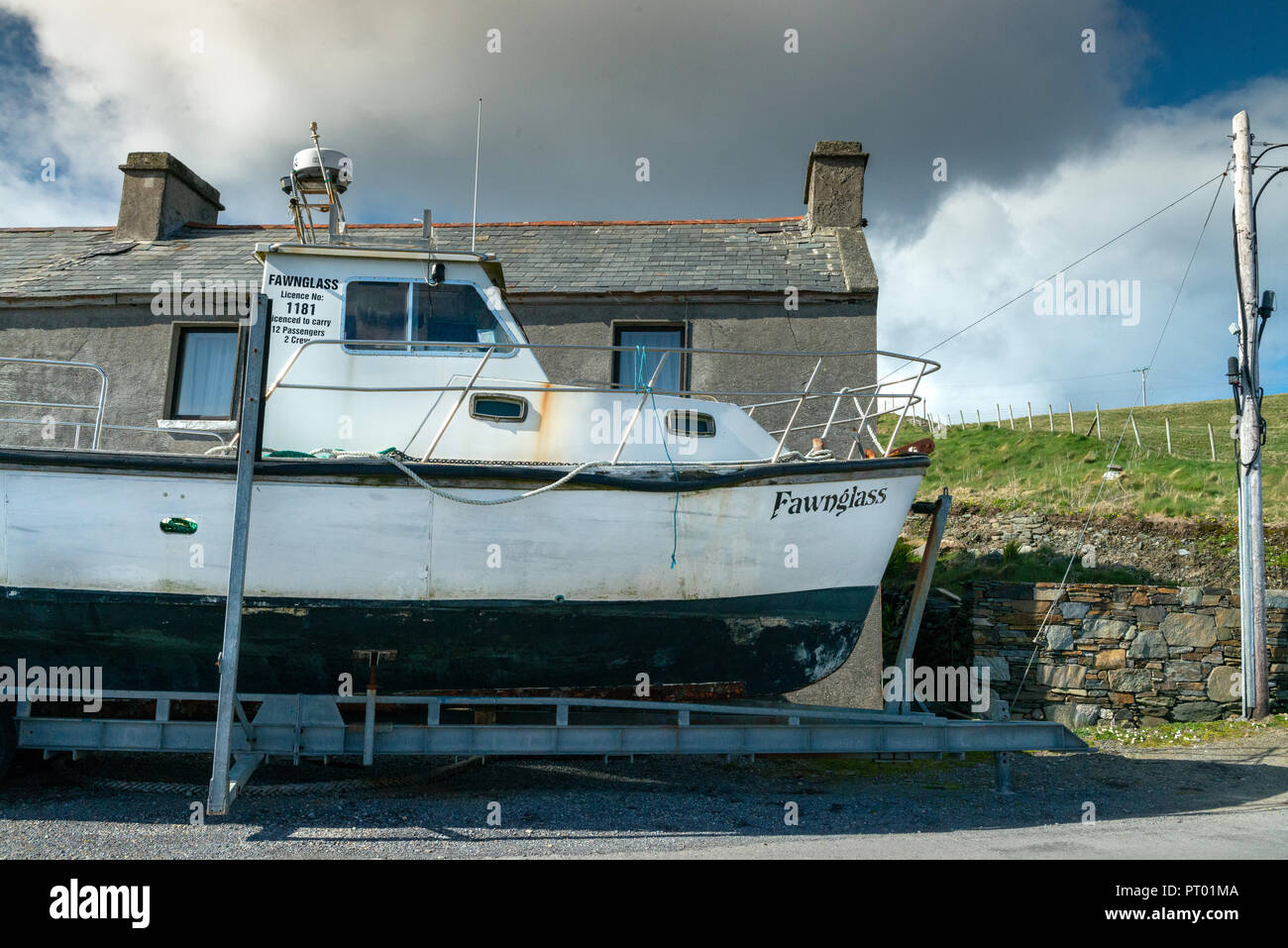 Ireland, Inish Boffin Island, Boat in dry dock waiting to be repaired and painted. Stock Photo