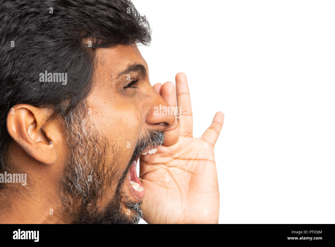 Close-up of indian man yelling as annoyed concept isolated on white background with blank copyspace for advertising - Stock Image