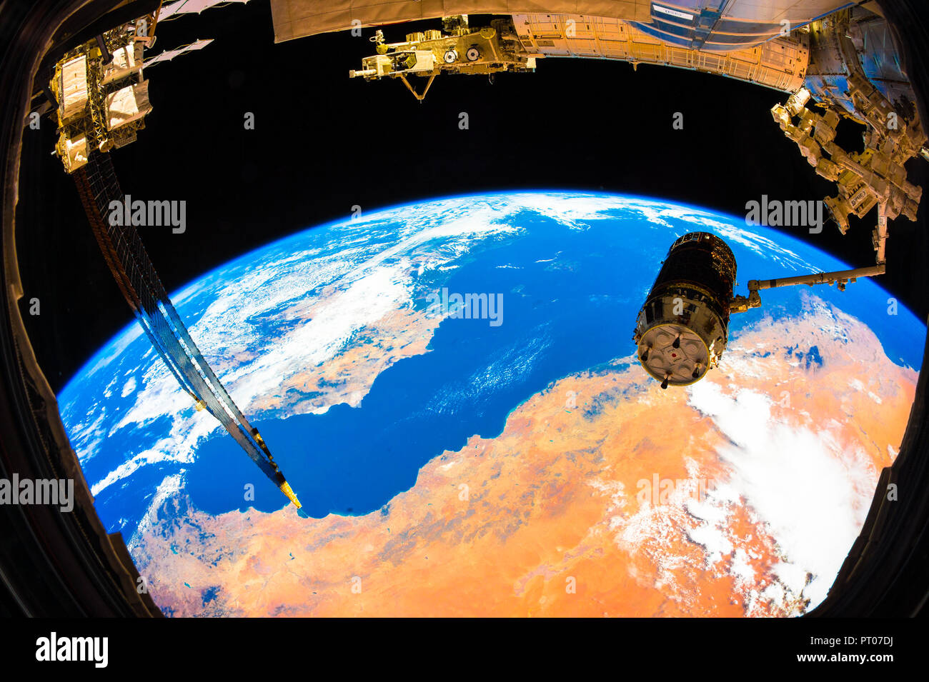 The JAXA's (Japan Aerospace Exploration Agency) H-II Transfer Vehicle-5 or 'Kounotori' in the grips of the International Space Station's Canadarm2 rob - Stock Image