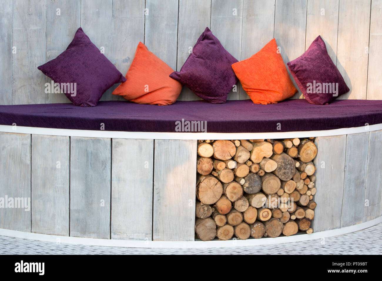 Wondrous Outdoor Seating Area With Cushions And Log Storage Ceramic Camellatalisay Diy Chair Ideas Camellatalisaycom