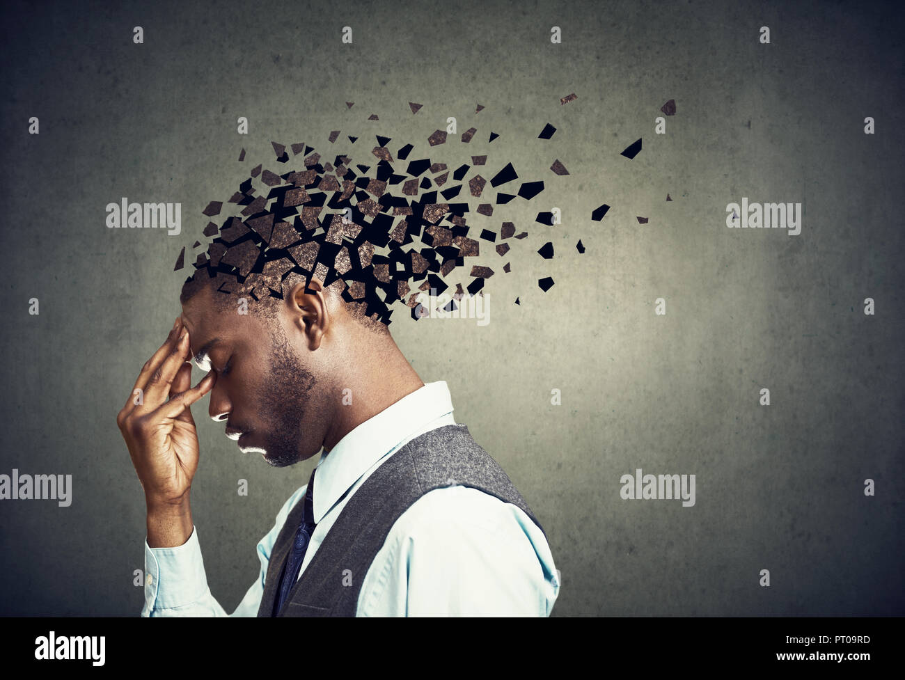 Memory loss due to dementia or brain damage. Side profile of a sad man losing parts of head as symbol of decreased mind function. - Stock Image