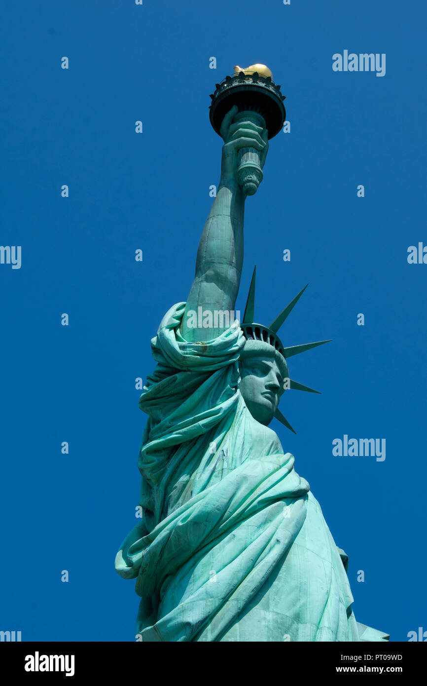 The Statue of Liberty in New York Harbour on a summer day in the USA Stock Photo