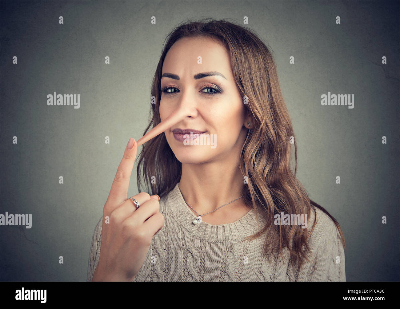A liar sly woman with long nose - Stock Image