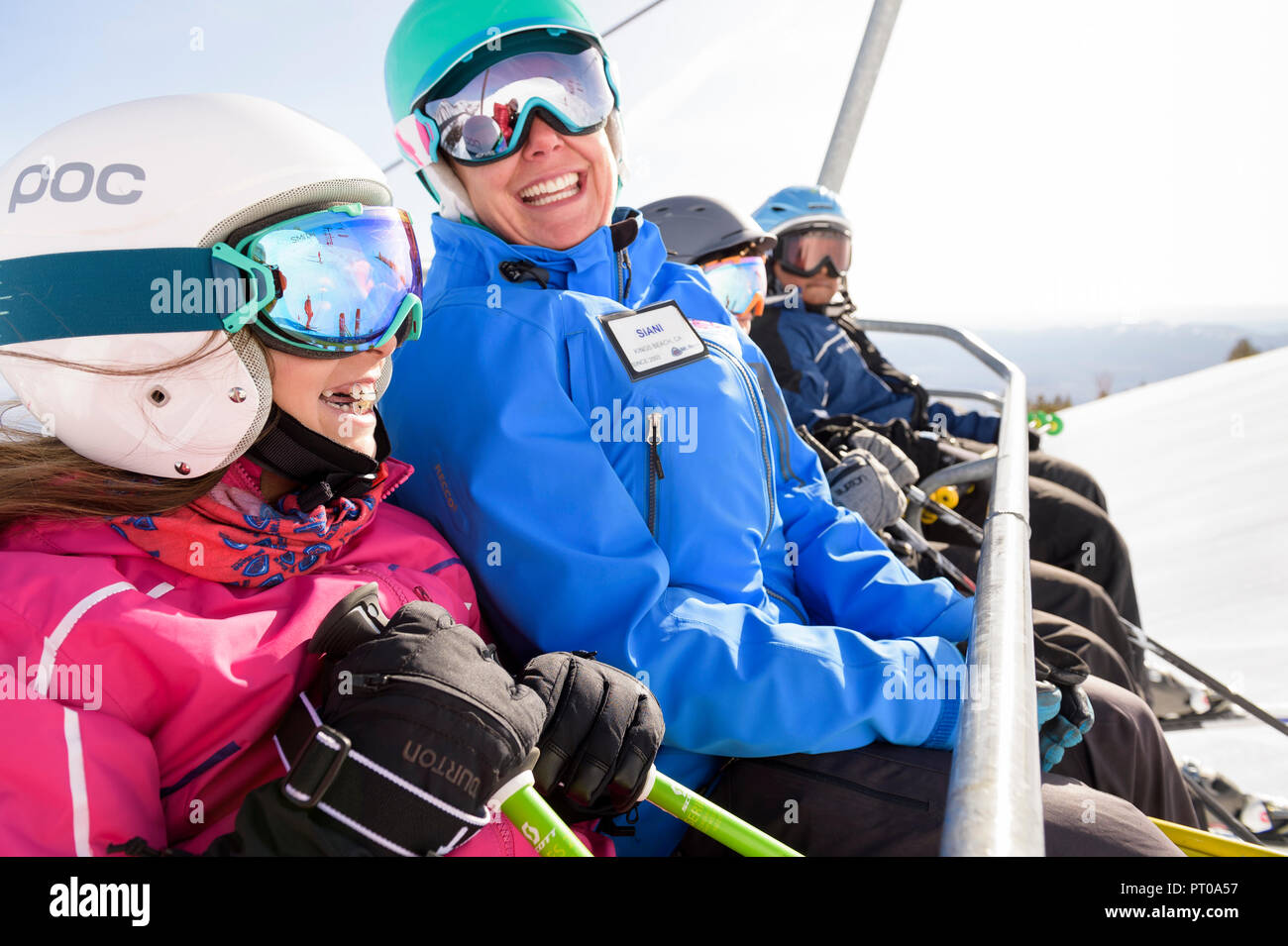 Ski instructor with kids during fun family ski lessons at Mt. Rose Ski Tahoe, the closest Lake Tahoe ski resort to Reno, Nevada, USA. Stock Photo