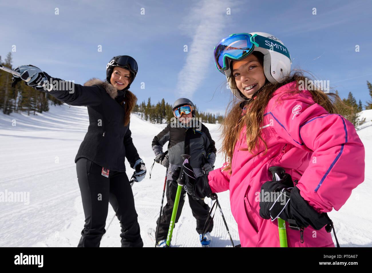 Ski instructor with kids during fun family ski lessons at Mt. Rose Ski Tahoe, the closest Lake Tahoe ski resort to Reno, Nevada, USA. Stock Photo