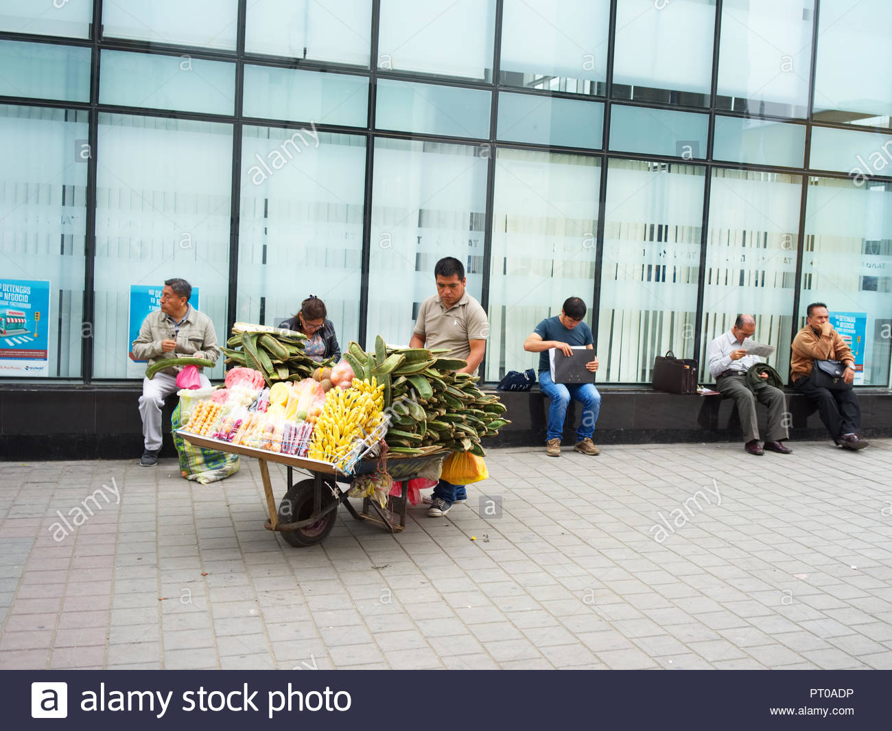 Street seller sells fruit on the pedestrian street in Trujillo Peru - Stock Image