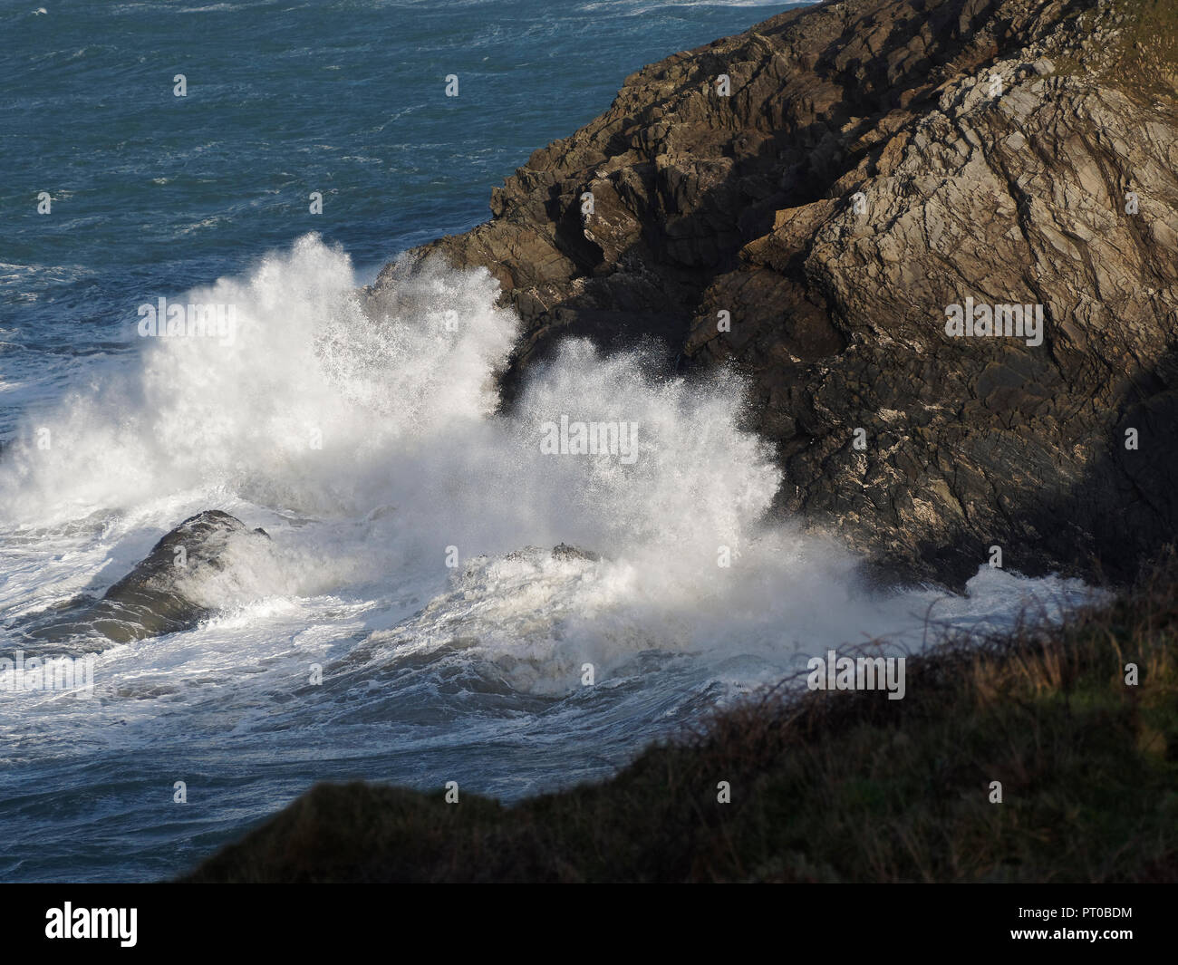 Waves unlit powerfull crash at Lewinnick cove Newquay cornwall UK - Stock Image