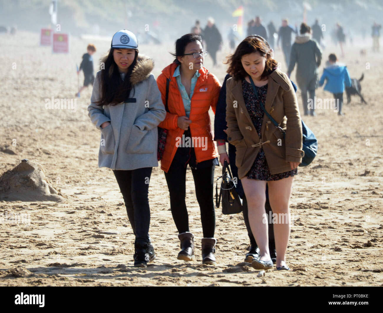 Asian tourist couples in Cornwall UK - Stock Image