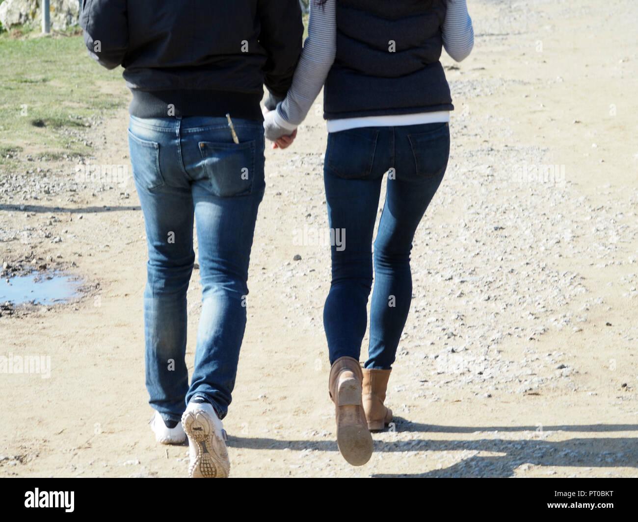 Couple Twenties rear view walking, - Stock Image