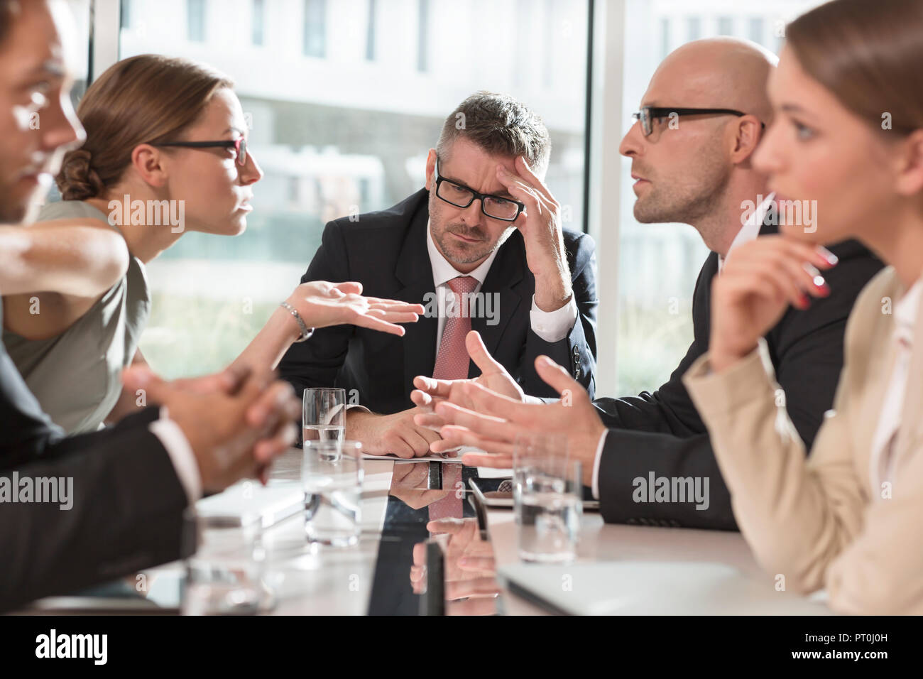 Poland, Warzawa, group of five businessmen in disagreement - Stock Image