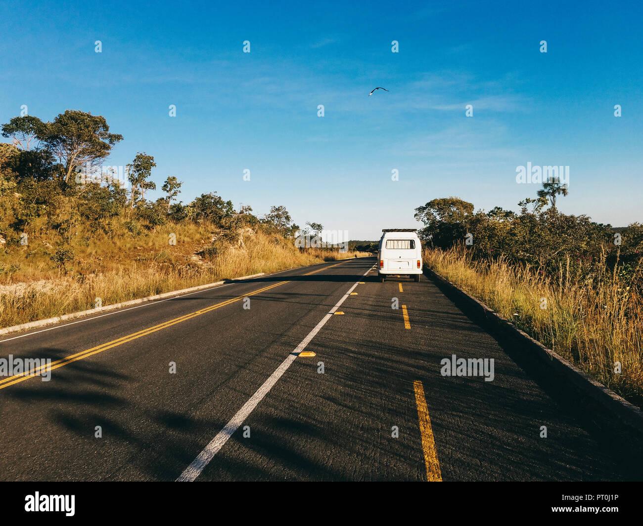 Brazil, Alto Paraiso de Goias, Camper on a country road - Stock Image