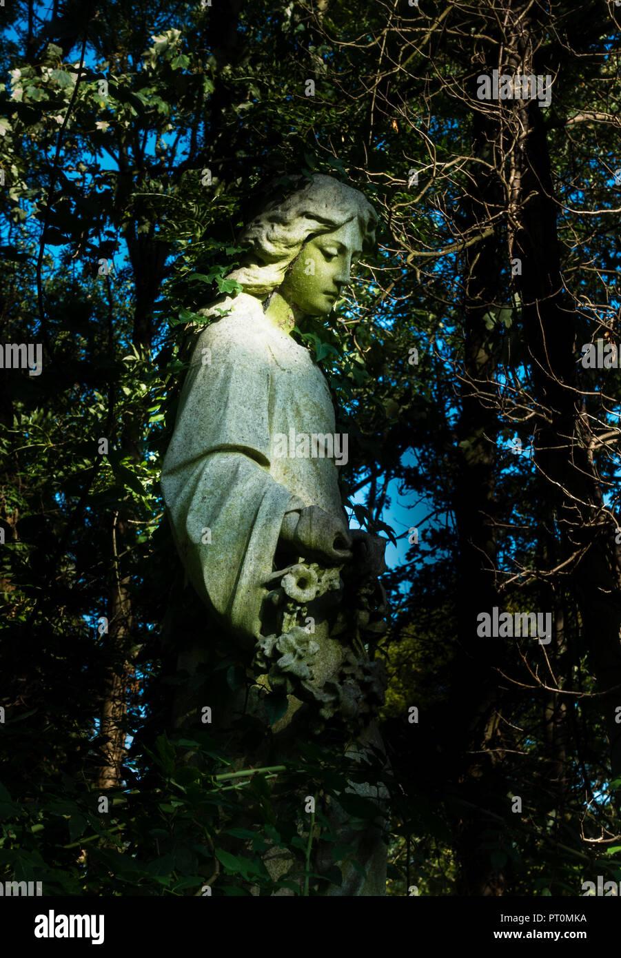 Stone angel in Highgate Cemetery, London Stock Photo
